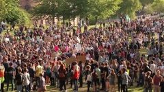 Crowd Protesting in Park with Signs - UK Austerity Protests: Election 2015 HD Stock Footage