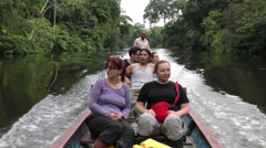 Group of people pointing out wildlife while navigating on Cuyabeno river, Stock Footage