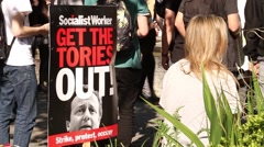 Girl With 'Get The Tories Out' Sign - UK Austerity Protests: Election 2015 HD Stock Footage