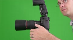 Green screen shot of photographer at the studio Stock Footage
