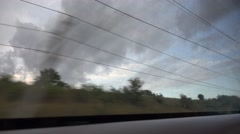 ULTRA HD 4K POV Point of view train window pass countryside cloudy storm rain  Stock Footage