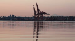 Shipping and Cargo Cranes in Port of Vancouver along English Bay at Sunrise Stock Footage