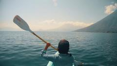 Woman kayaking on lake Stock Footage