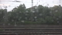 ULTRA HD 4K POV Point of view train arrive station heavy rain storm village day  Stock Footage