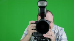Green screen shot of photographer in the studio Stock Footage