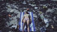 Stock Video Footage of Model posing in polluted beach