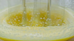 Beating egg yolk combined with sugar Stock Footage