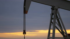 Oil pump with sunrise in the background Stock Footage