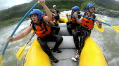Very expressive faces of a group of people while whitewater rafting a level four Stock Footage