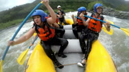 Stock Video Footage of Very expressive faces of a group of people while whitewater rafting a level four
