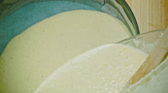Pouring the mixture of sponge into a baking tin, close up Stock Footage