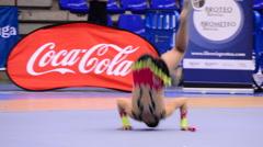 Gymnast with sticks on rhythmic gymnastics tournament Stock Footage