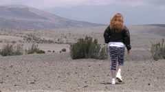 Adult woman taking a short walk into the Andean high altitude desert - stock footage
