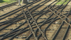 Empty Train yard - small freight engine passes thru shot (mute) Stock Footage