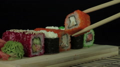 Sushi on a black background Stock Footage