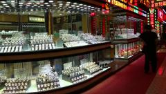 Small shops selling gold products, watches and diamonds in Macao Stock Footage