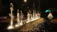 Fountain in the square in the modern district of Macao in the evening - stock footage