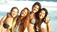 Young Brazilian women smile on a beach in Brazil - stock footage