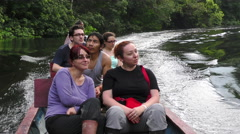 Group of tourists riding a motorized canoe in Cuyabeno Wildlife Reserve, Ecuador Stock Footage