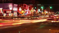 People and Traffic at Night on Broadway Ave in Nashville Tennessee Stock Footage