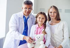 Paying visit to doctor Stock Photos