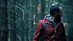 Young, frightened man running through the forest HD Stock Footage