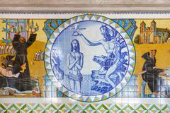 Baptism of Jesus. Crypt tiles showing Bible and St Benedict life. Stock Photos