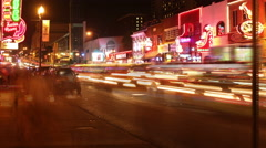 Stock Video Footage of People and Traffic at Night on Broadway Ave in Nashville Tennessee