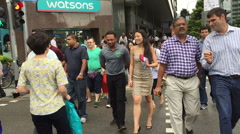 Slow motion crowd of multi ethnic Singapore business people cross the road Stock Footage