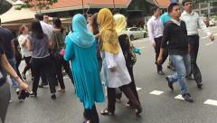 Slow motion, Singapore muslim women people walk across Cross Street Stock Footage