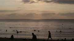 Vietnamese people swim in tranquil sea at dawn Stock Footage
