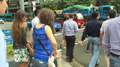 Slow motion of multi ethnic Singapore business people crossing the road - stock footage