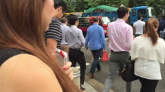 Slow motion crowd of multi ethnic Singapore people cross the road - stock footage