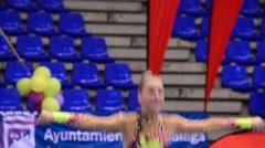 Young gymnast on rhythmic gymnastics tournament - stock footage
