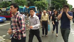 Slow motion,  crowd of multi ethnic Singapore people - stock footage