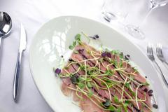 Smoked tuna Carpaccio with bean sprouts and soy sauce reduction Stock Photos
