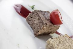 Venison pate with a reduction of red wine Stock Photos