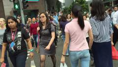 Slow motion,  crowd of multi ethnic Singapore business people - stock footage