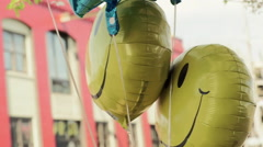 Closeup Of Smiley Face Balloons, Swaying And Moving In The Breeze (Slow Motion) Stock Footage