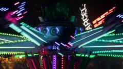Fairground attraction by rotating at night with large colorful. - stock footage