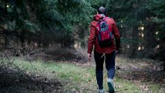 Young man trekking on the forest HD Stock Footage