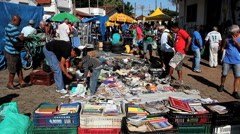 Antiques, old merchandise at the flea market. People at street market, Brazil. Stock Footage