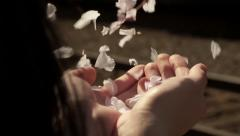Young Woman Holds A Handful Of Flower Petals, They Blow Away In The Wind - stock footage
