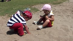 Boy and girl play on the sand Stock Footage
