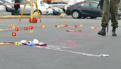 Police investigating a crime scene with evidence markers - Commercial licensing Stock Footage