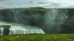 Water Flows into the Earth at GULFOSS WATERFALL,  ICELAND Stock Footage