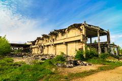 Demolished buildings, industrial ruins, earthquake Stock Photos