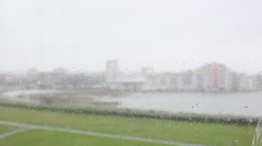 rain on the window bay and building in bg - stock footage