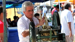 People at street market, Brazil. Caldo de cana is a popular brazilian beverage. Stock Footage