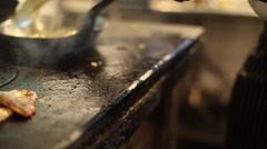 Frying rice on wood burning stove, medium shot Stock Footage